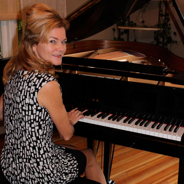 Tricia Dalgleish playying a Grand Piano
