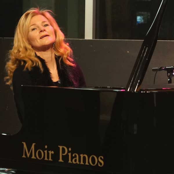 Tricia Dalgleish singing and playing Piano